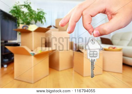 Hand with house key.