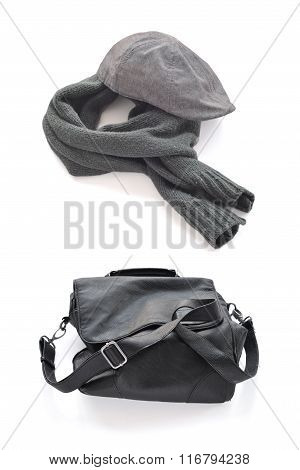 Gray cap warm scarf and Black wrinkled leather bag with shoulder strap.