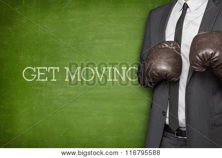 Get moving on blackboard with businessman on side