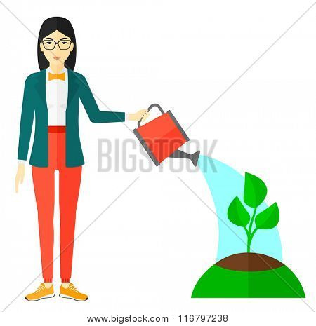 Woman watering tree.