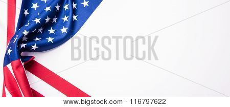 USA flag. American flag. American flag blowing wind. Close-up. Studio shot. Banner with a USA flag.