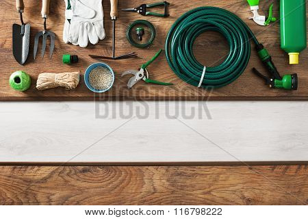 Gardening and farming tools on a wooden table and blank copy space top view