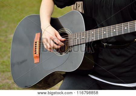 Woman Playing Black Guitar