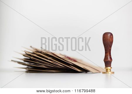 Wooden wafer standing near pack of letters
