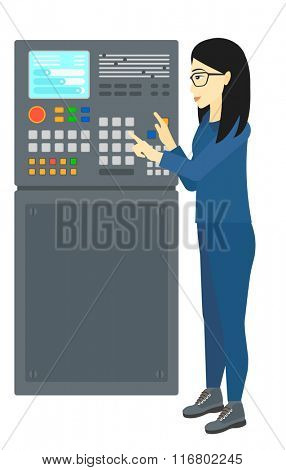Engineer standing near control panel.