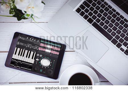 Music app against tablet on desk