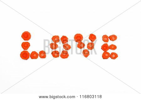 Word Love laid out sliced carrots on a white background