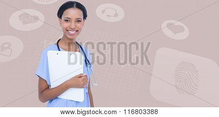 Smiling female surgeon holding clipboard against beige background