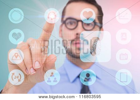 Businessman with glasses pointing something against blue background