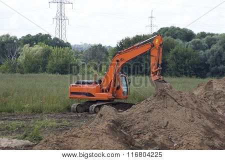 Excavator In The Field