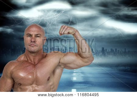 Portrait of muscular man flexing bicep against stormy sky with tornado over road
