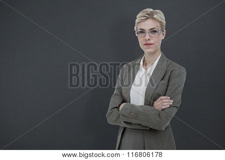 Businesswoman smiling on a white background against grey background