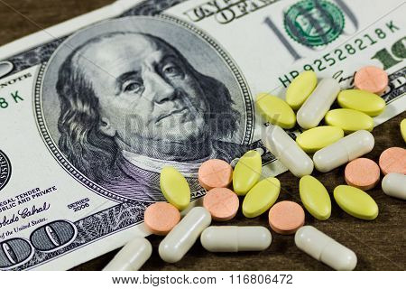 One hundred dollars and pills