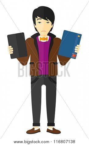 Man choosing between book and tablet computer.