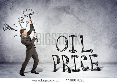 Businessman with hammer and word oil price