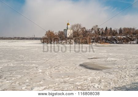 Landscape with frozen river Dnepr and Orthodox church