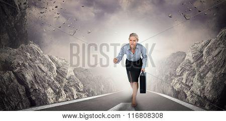 Businesswoman running and holding briefcase against dark road landscape