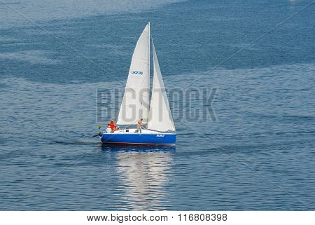 Yacht passing by turning buoy in the sailing race on the Dnepr river