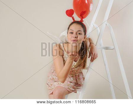 Cute Beautiful Angel Girl Blowing You A Kiss