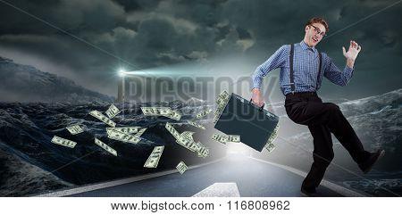 Running businessman against headlight road landscape
