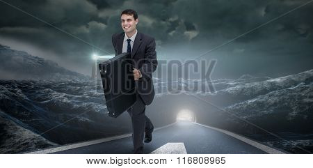 Smiling businessman in a hurry against headlight road landscape
