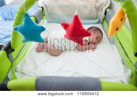 Newborn baby in bed