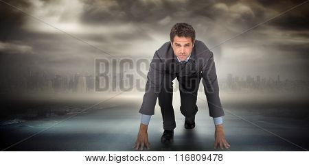 Focused businessman ready to race against stormy sky with tornado over road