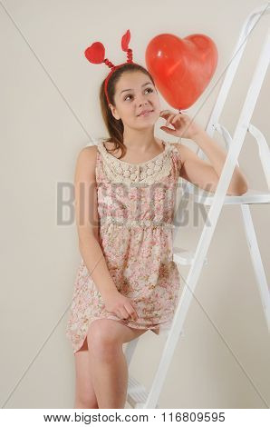 Cute Beautiful Girl Dreaming About Valentine's Day On Stairs