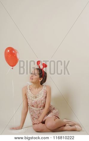 Cute Beautiful Girl Looking At Red Balloon Heart