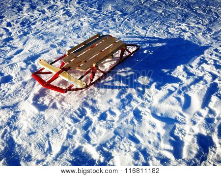 Sledding in snow fresh powder tracks