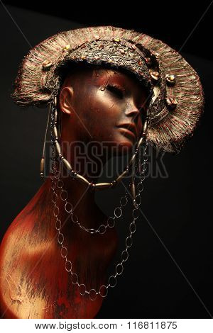 Mannequin in golden headwear