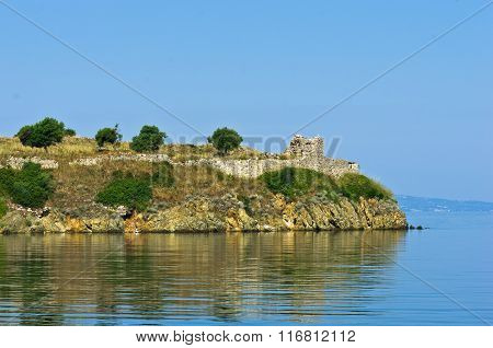 Ruins of old roman fortress with sea coast in background, Sithonia, Greece