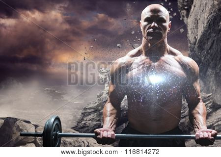 Portrait of muscular man lifting crossfit against rock crashing down from cliff