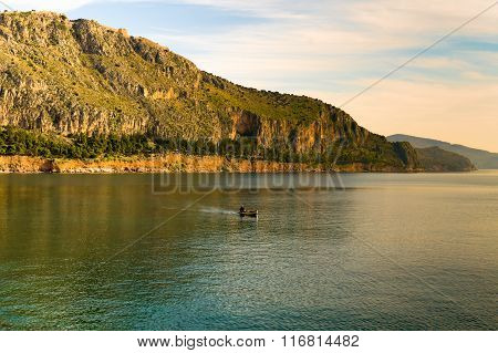 Landscape with a fishing boat against the beautiful scenic in Nafplio in Greece.