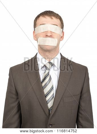 Businessman with tape over his eyes and mouth