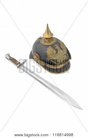 Old German helm (1895) so called Pickelhaube (peaked helm) with bayonet to Mauser rifle