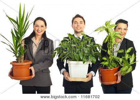 Happy Business People Holding Vases With Plants