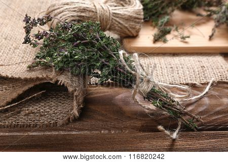 Bunch Of Organic Thyme On Wooden Table