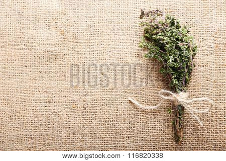 Bunch Of Organic Thyme On Burlap Background