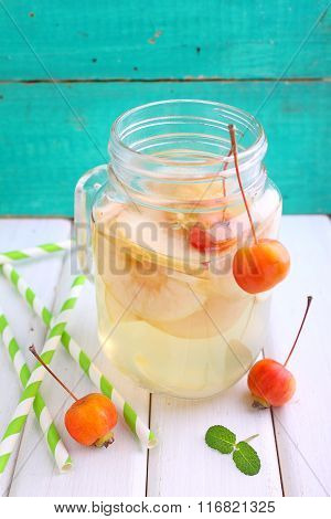 A Jug Of Apple Compote On A Bright Wooden Background
