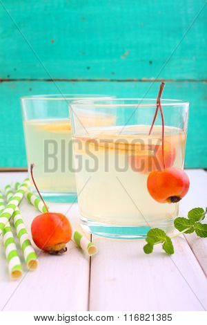 Glasses With Apple Compote On A Bright Wooden Background