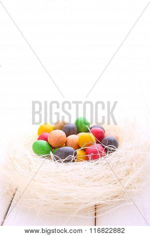 Colorful Chocolate Eggs In The Nest Of Straw