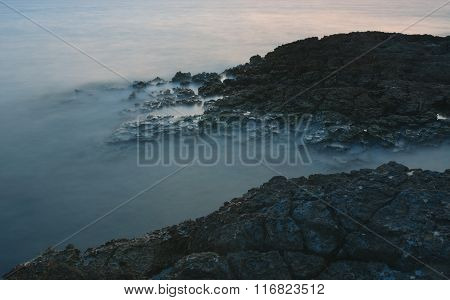 Rocky Coast After Sunset In The Evening In Croatia