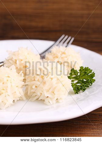 Hedgehogs, Chicken Cutlet With Rice On A Plate On A Dark Background