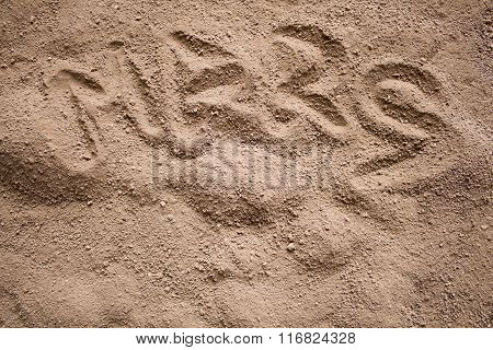 Mars Word Painted On A Dark Sand With Bumps