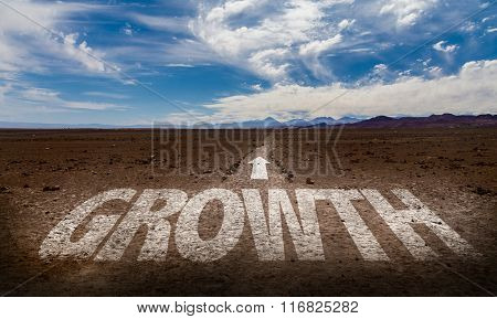 Growth written on desert road