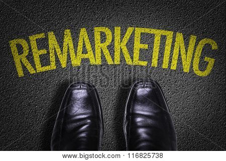 Top View of Business Shoes on the floor with the text: Remarketing