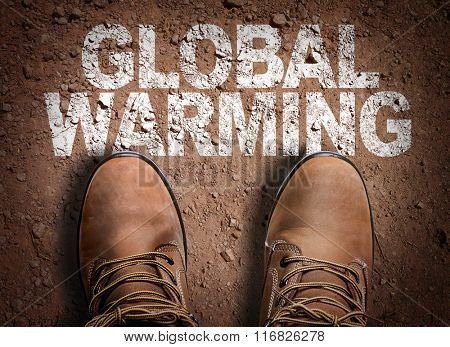 Top View of Boot on the trail with the text: Global Warming