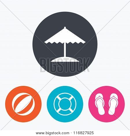 Beach holidays icons. Umbrella and sandals.