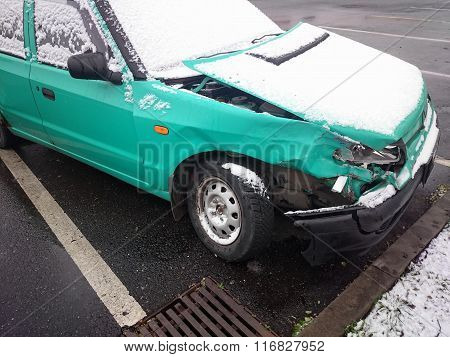 Crashed Car. Green Wreck Under Dusting Of Snow
